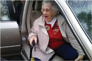 WOMAN WITH CANE SITTING IN CAR
